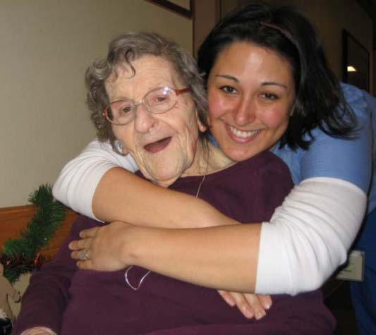 An elderly woman with a support person