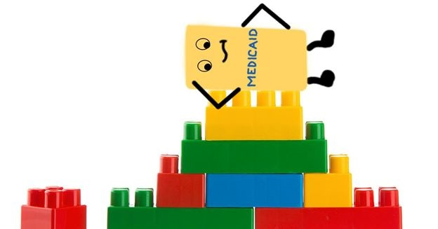 stack of Lego blocks with Mediciad on top